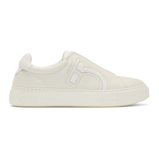 Photo: Salvatore Ferragamo Off-White Gancini Slip-On Sneakers