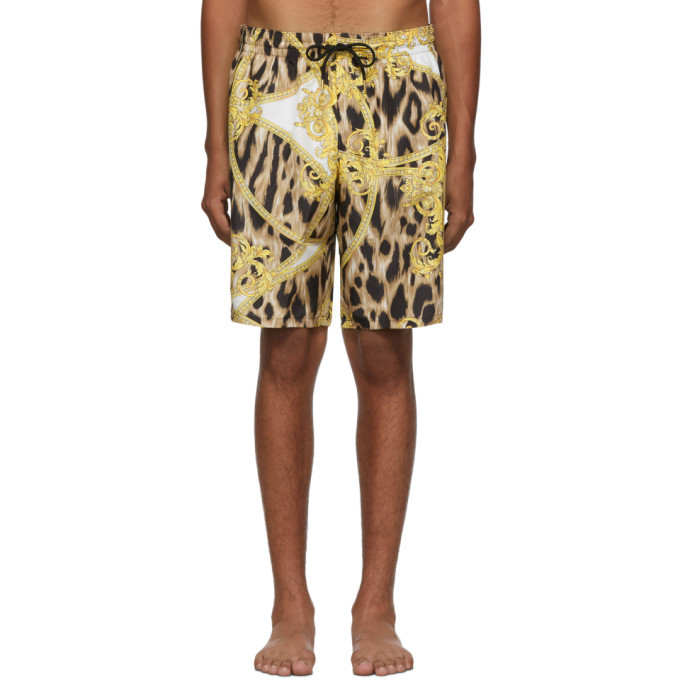 Photo: Versace Underwear White and Gold Animal Swim Shorts