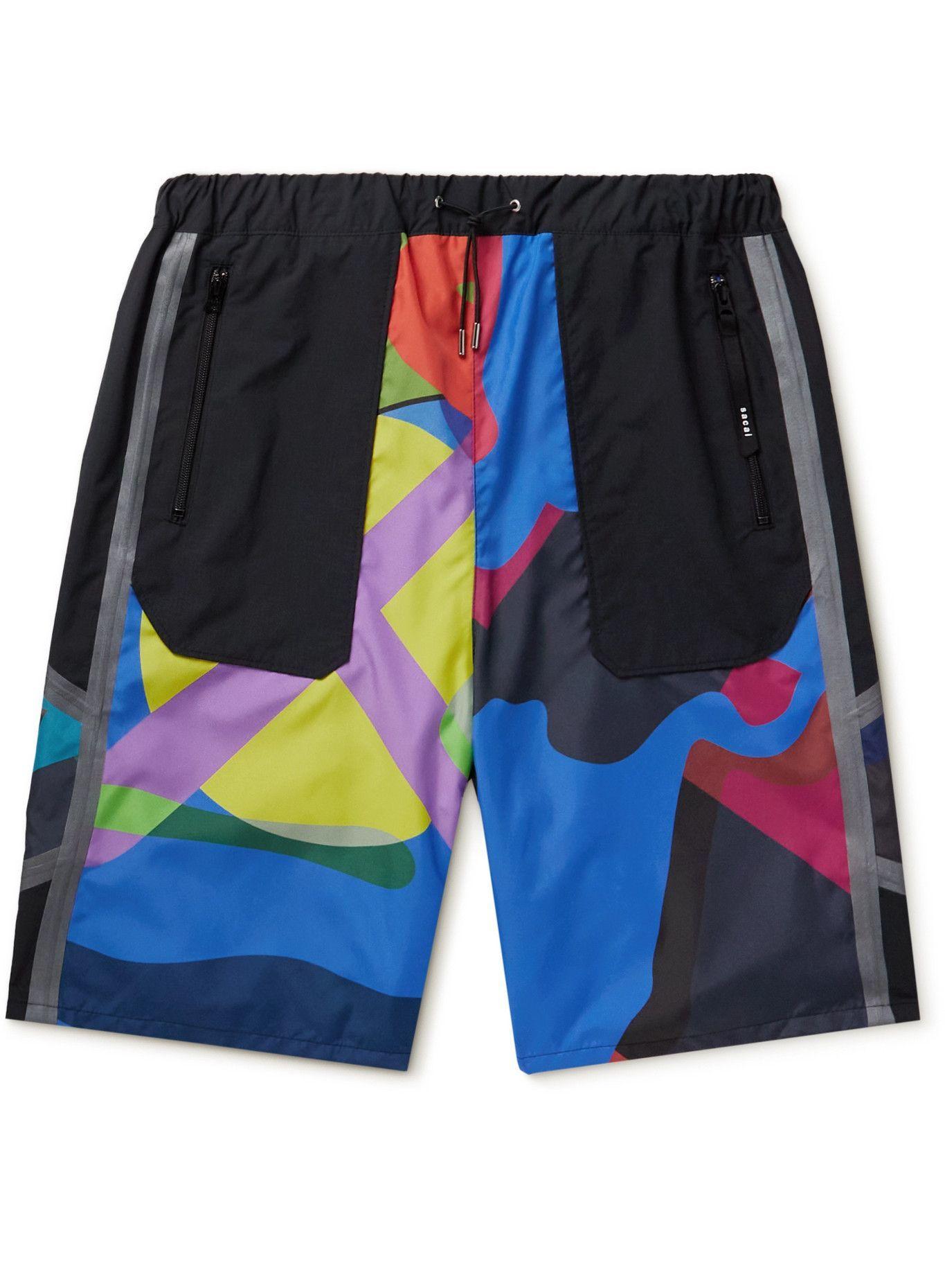 Photo: Sacai - KAWS Wide-Leg Printed Shell Drawstring Shorts - Multi