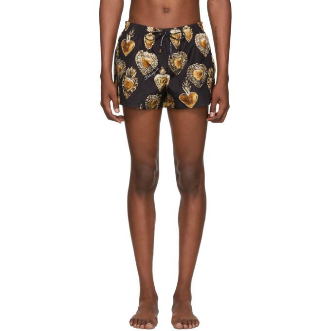 Photo: Dolce and Gabbana Black and Gold Sacred Heart Swim Shorts