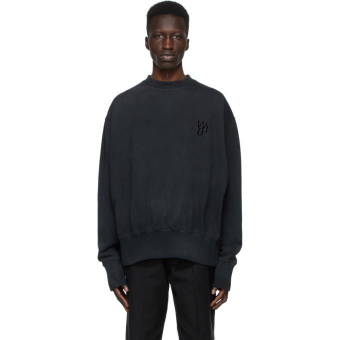 Photo: We11done Black Glow-In-The-Dark Teddy Sweatshirt