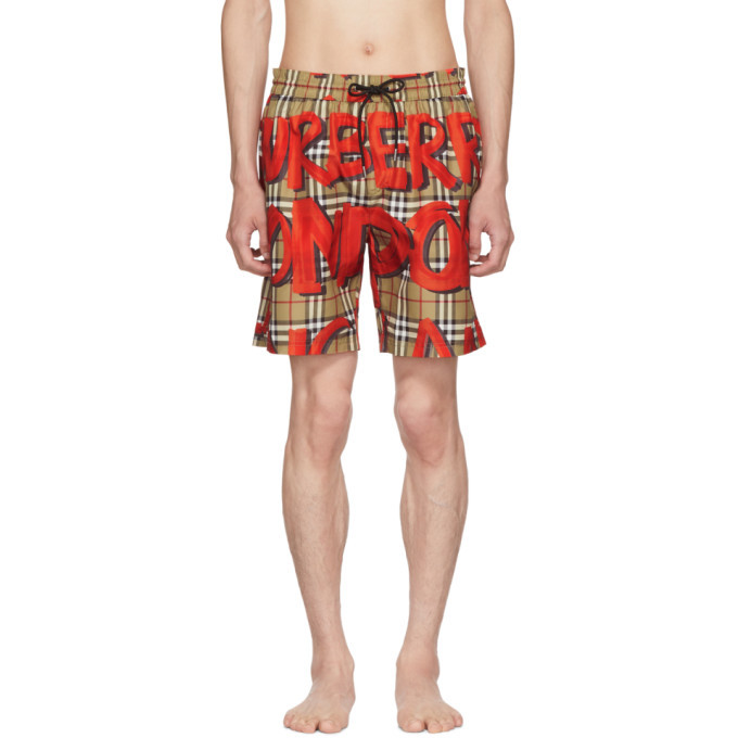 Photo: Burberry Beige and Red Graphic Check Swim Shorts