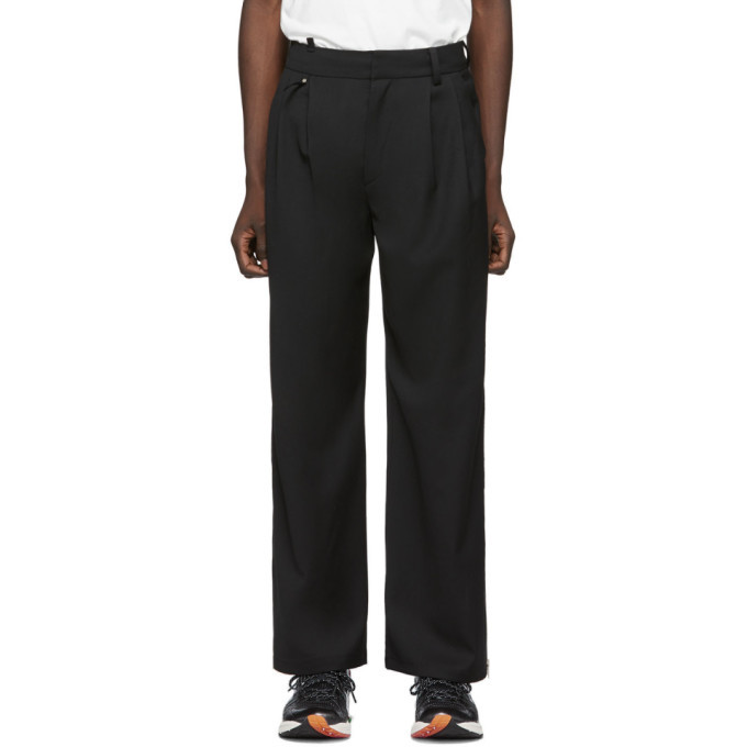 Photo: ADER error Black Two-Way Trousers