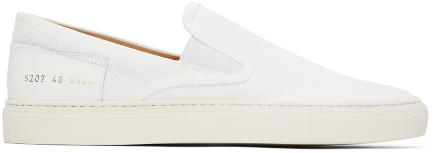Photo: Common Projects White Canvas Slip-On Sneakers