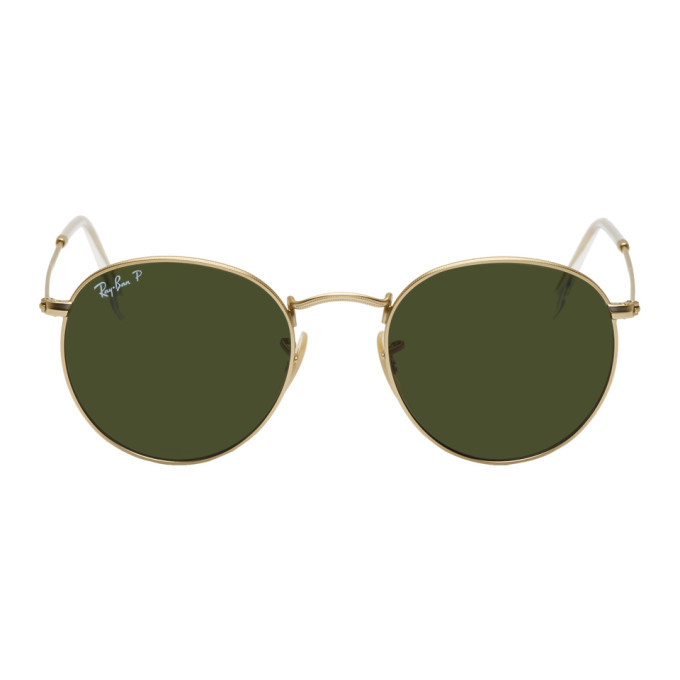 Photo: Ray-Ban Gold and Green Round Phantos Sunglasses