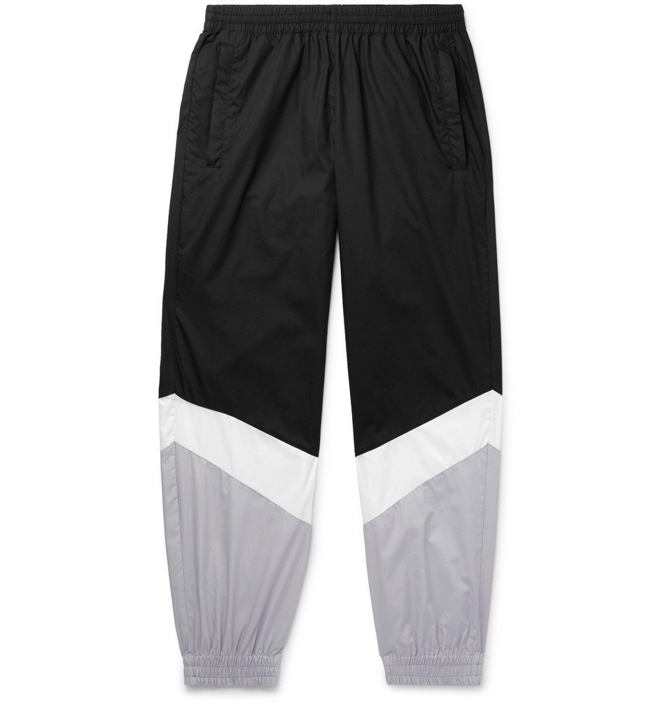 Photo: Vetements - Tapered Panelled Coated-Cotton Sweatpants - Black