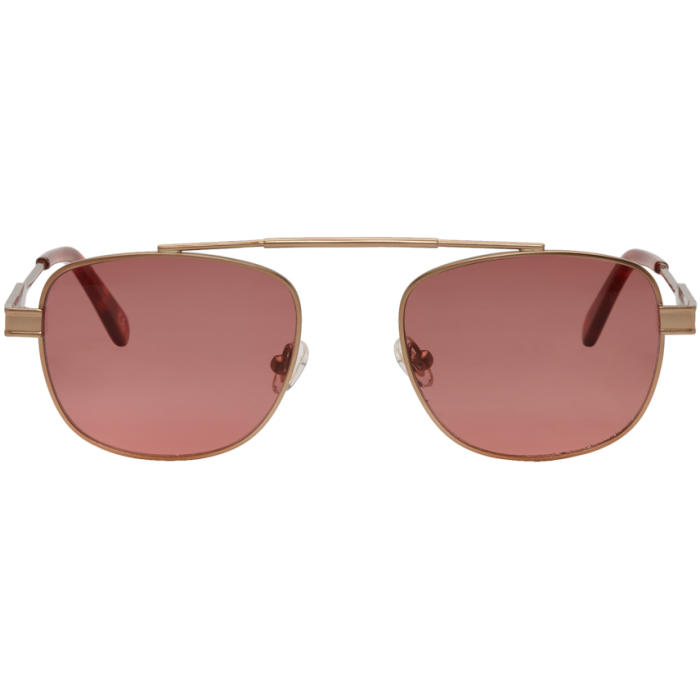 Photo: Han Kjobenhavn Gold and Red Clint Sunglasses