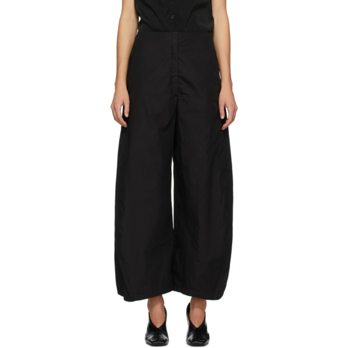 Photo: Lemaire Black Curved Trousers