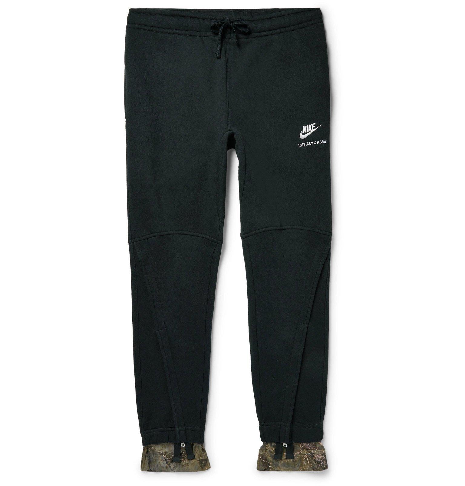 Photo: 1017 ALYX 9SM - Nike Tapered Camouflage-Print Trimmed Fleece-Back Cotton-Blend Jersey Sweatpants - Black