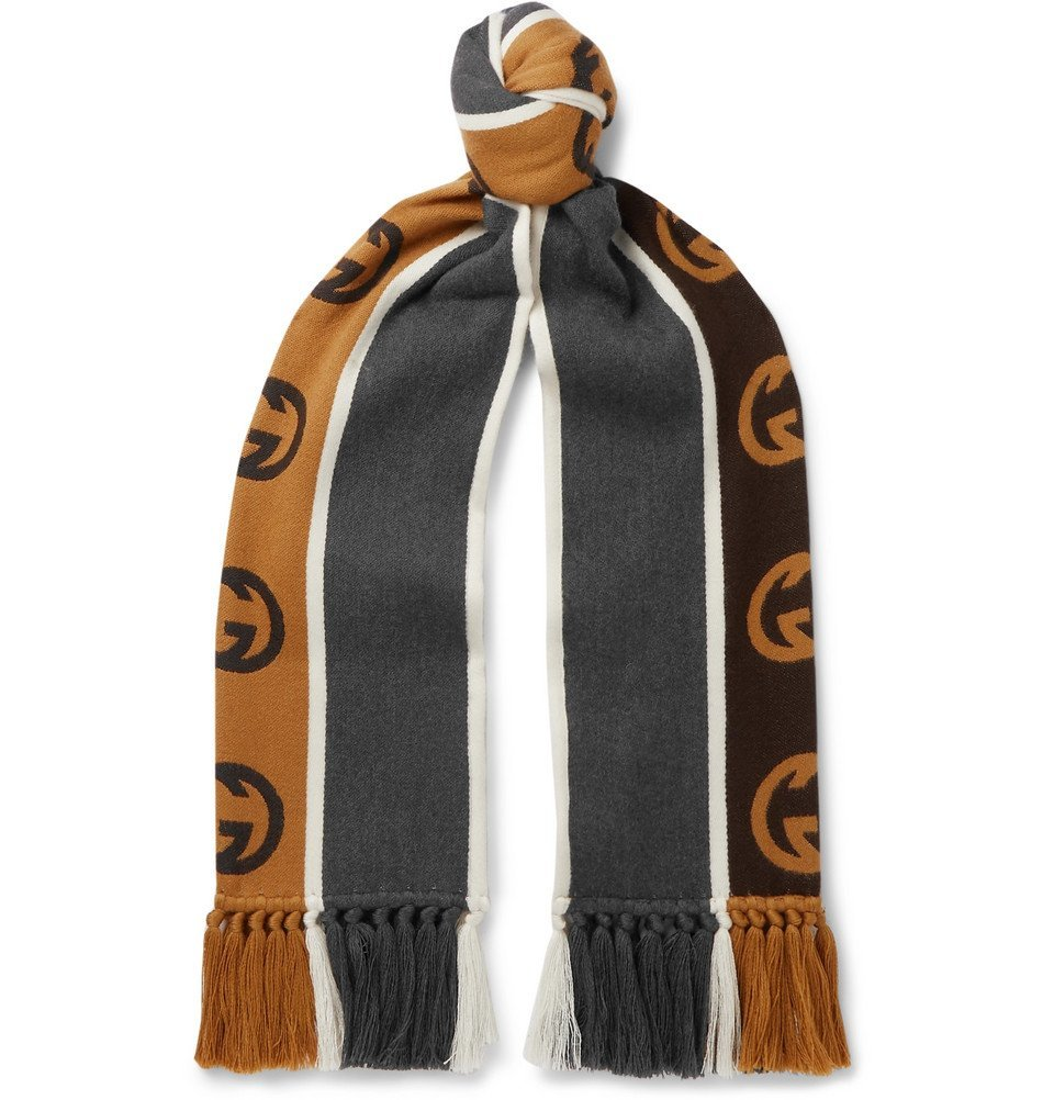 Photo: Gucci - Tasselled Striped Logo-Intarsia Wool and Cotton-Blend Scarf - Gray