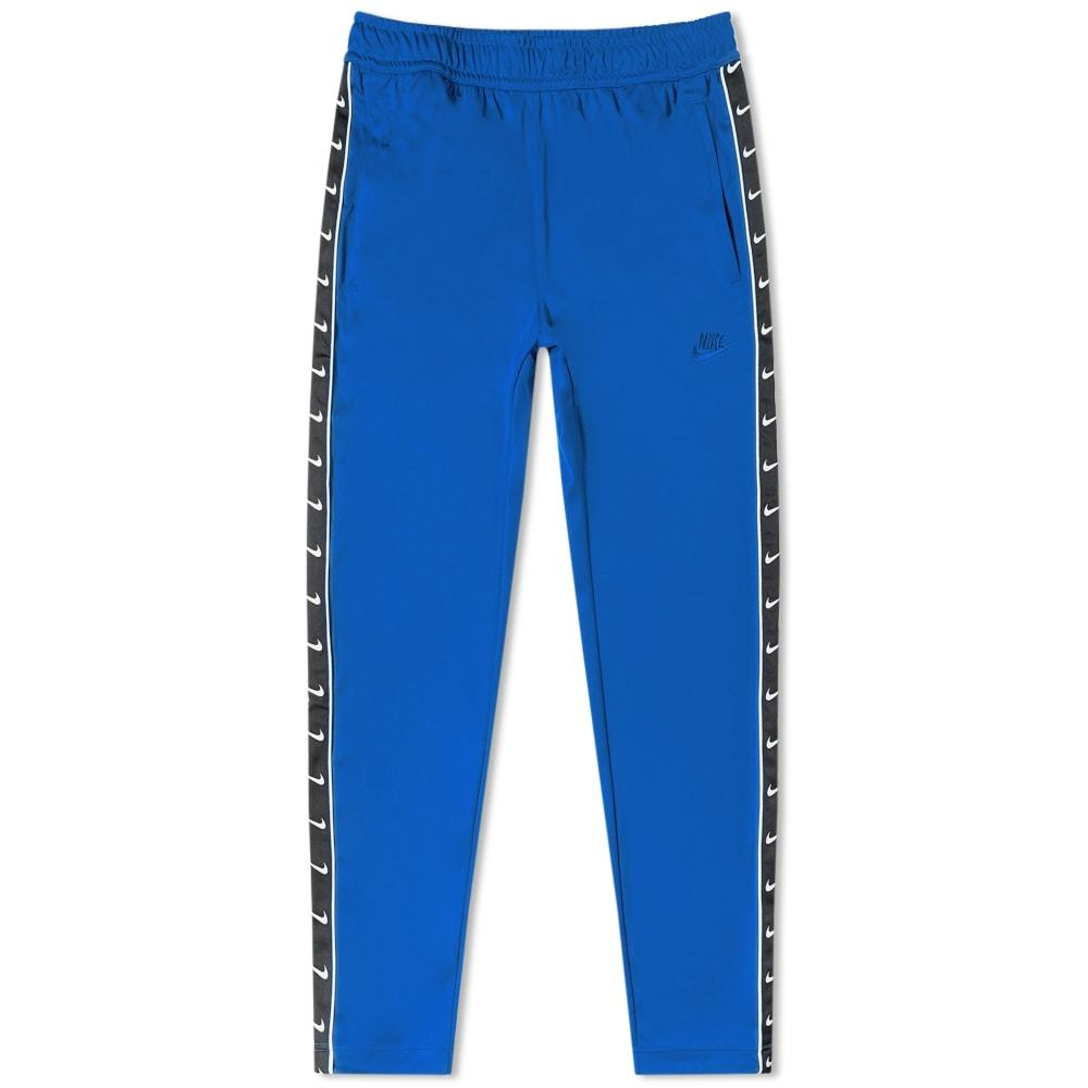 Photo: Nike Taped Poly Track Pant