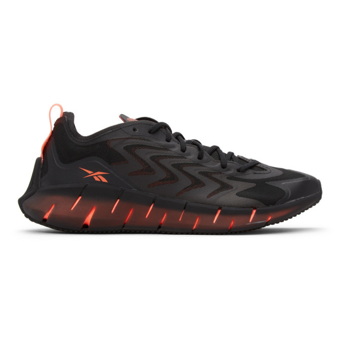 Photo: Reebok Classics Black and Orange Zig Kinetica 21 Sneakers