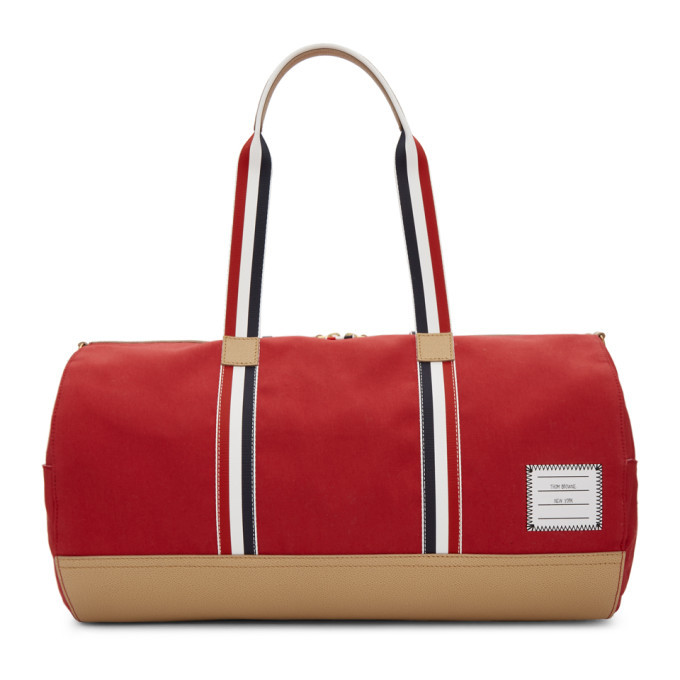 Thom Browne Red Gym Duffle Bag. Cotton twill duffle bag in red. Pebble grained  leather trim ... 7a6371aa2bc17