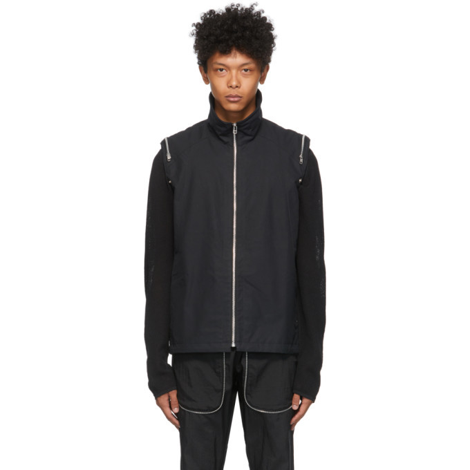Photo: Arnar Mar Jonsson Black Convertible Vest Jacket