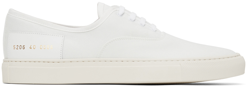 Photo: Common Projects White Canvas Four Hole Sneakers