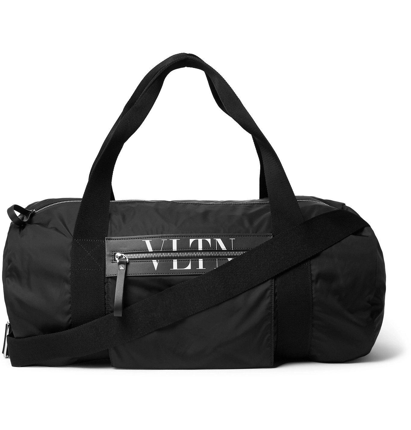 Photo: Valentino - Valentino Garavani Logo-Print Leather-Trimmed Shell Duffle Bag - Black