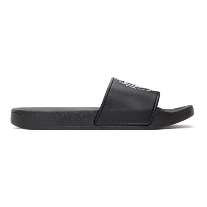 Photo: Total Luxury Spa SSENSE Exclusive Black Rubber Logo Pool Slides