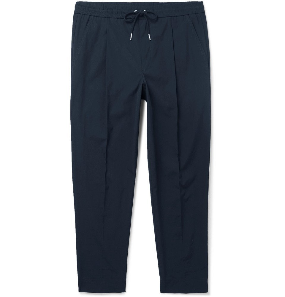 Photo: Moncler - Tapered Pleated Stretch-Cotton Drawstring Trousers - Navy