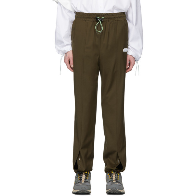 Photo: ADER error Khaki Rivet Label Track Pants