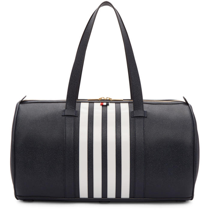 Photo: Thom Browne Navy Unstructured Four Bar Gym Bag
