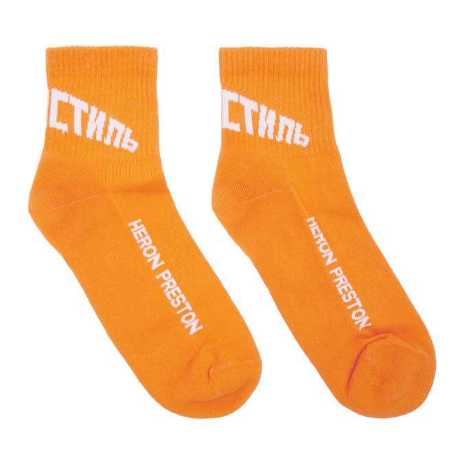Photo: Heron Preston Orange and White Logo Socks