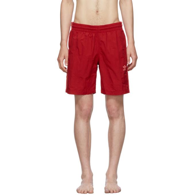 302b0c23e45 Photo: adidas Originals Red 3-Stripes Swim Shorts