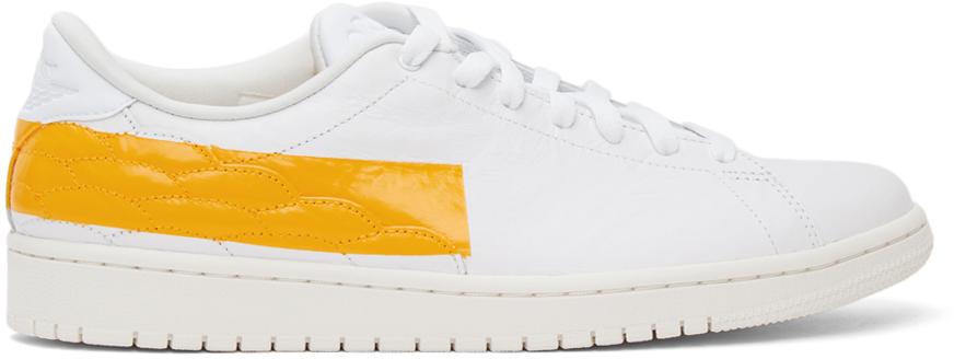 Photo: Nike Jordan White & Yellow Air Jordan 1 Centre Court Sneakers