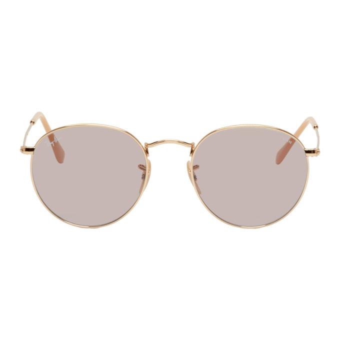 Photo: Ray-Ban Gold and Grey Round Phantos Sunglasses