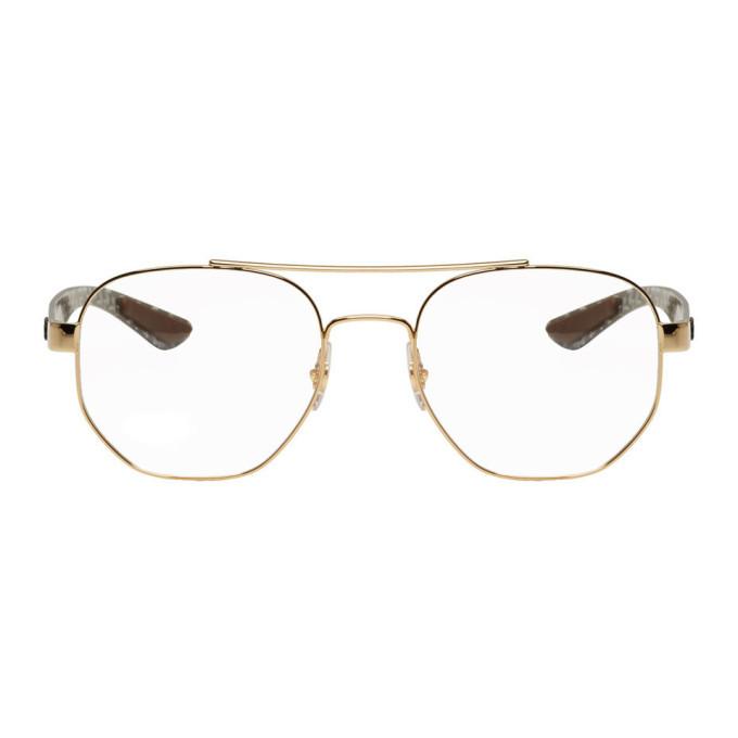 Photo: Ray-Ban Gold RB8418 Aviator Glasses