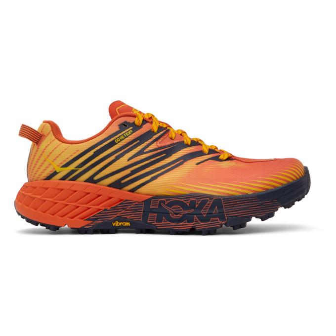 Photo: Hoka One One Red and Yellow Speedgoat 4 GTX Sneakers