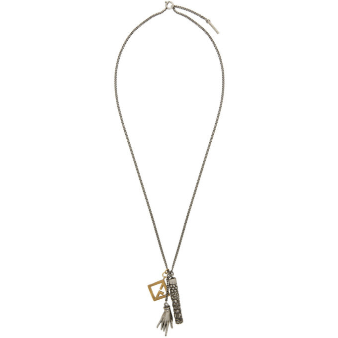 Photo: Givenchy Silver and Gold Talisman Multicharm Necklace