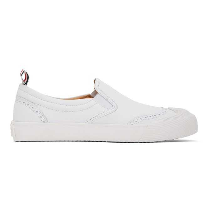 Photo: Thom Browne White Vulcanized Brogued Slip-On Sneakers