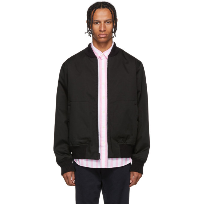 Photo: Woolrich John Rich and Bros Reversible Black Bomber Jacket
