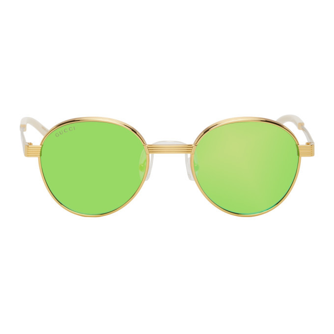 Photo: Gucci Gold and Green GG0872S Sunglasses
