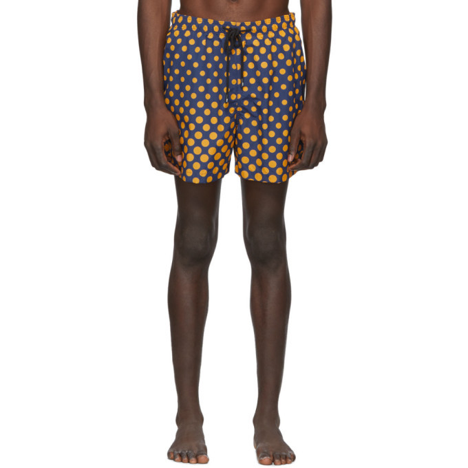 Photo: Solid and Striped Navy and Orange Ombre Dot The Classic Swim Shorts