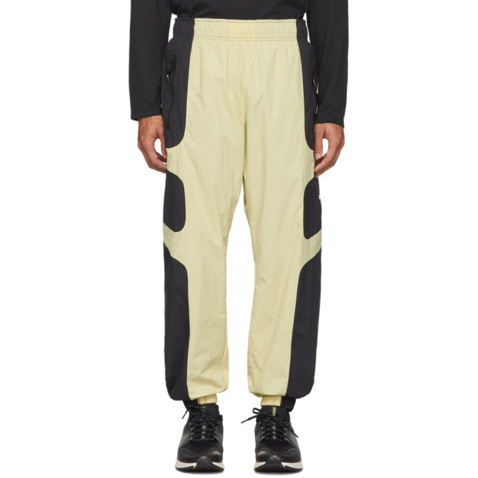 Photo: Nike Beige and Black NSW Re-Issue Track Pants