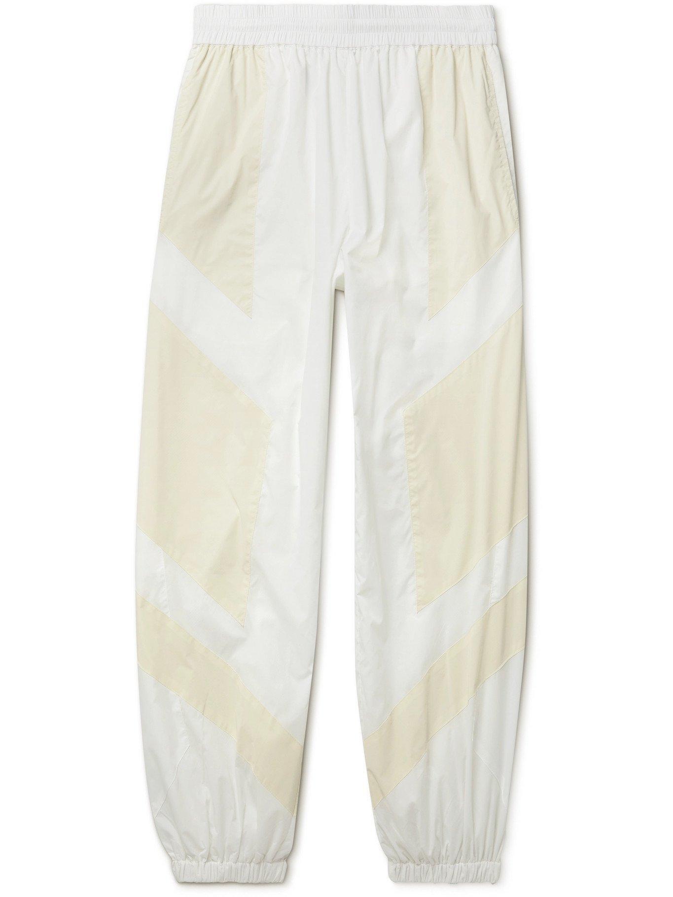 Photo: MCQ - Fantasma Glow-in-the-Dark Panelled Shell Track Pants - White