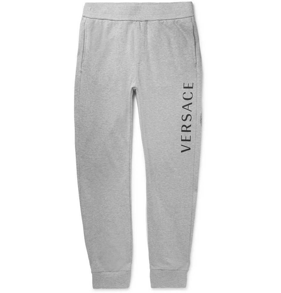 Photo: Versace - Slim-Fit Tapered Logo-Print Mélange Loopback Cotton-Jersey Sweatpants - Gray