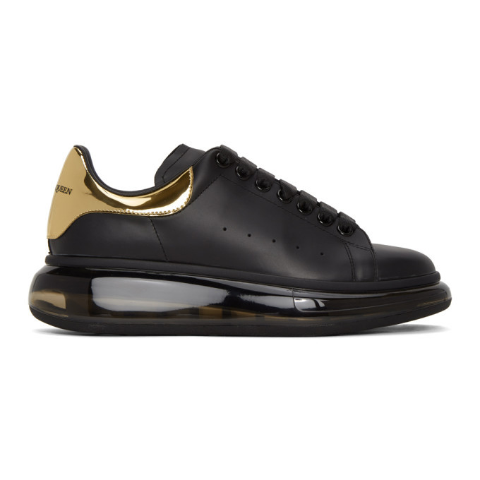Photo: Alexander McQueen Black and Gold Clear Sole Oversized Sneakers