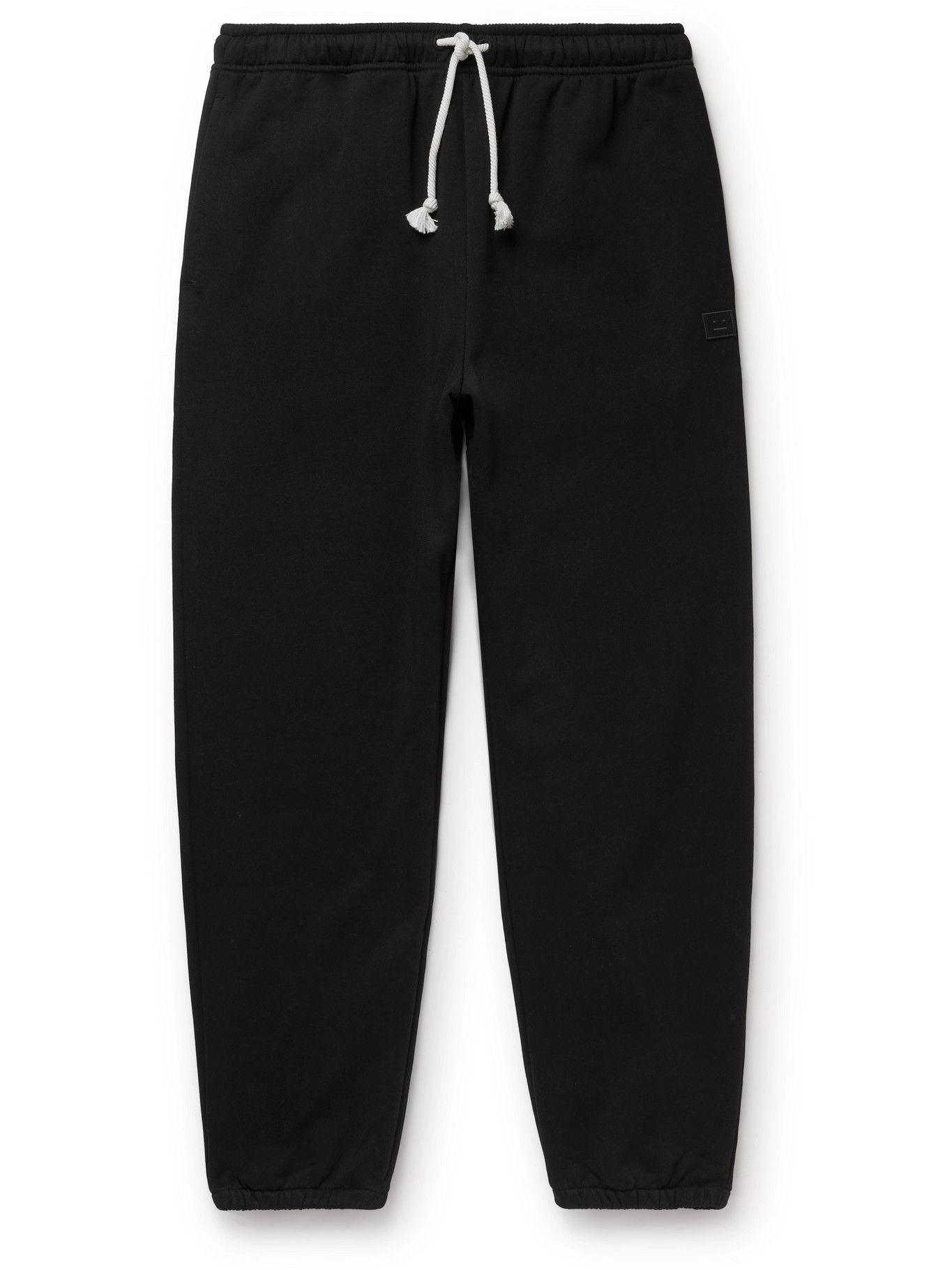 Photo: ACNE STUDIOS - Tapered Logo-Appliquéd Cotton-Jersey Sweatpants - Black