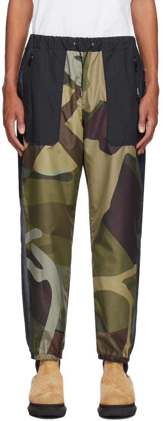 Photo: Sacai Green & Black KAWS Edition Camo Lounge Pants