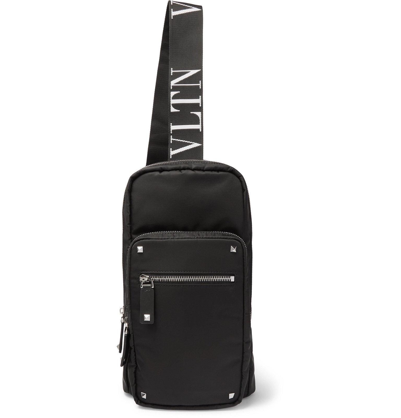 Photo: Valentino - Valentino Garavani Leather-Trimmed Shell Sling Backpack - Black