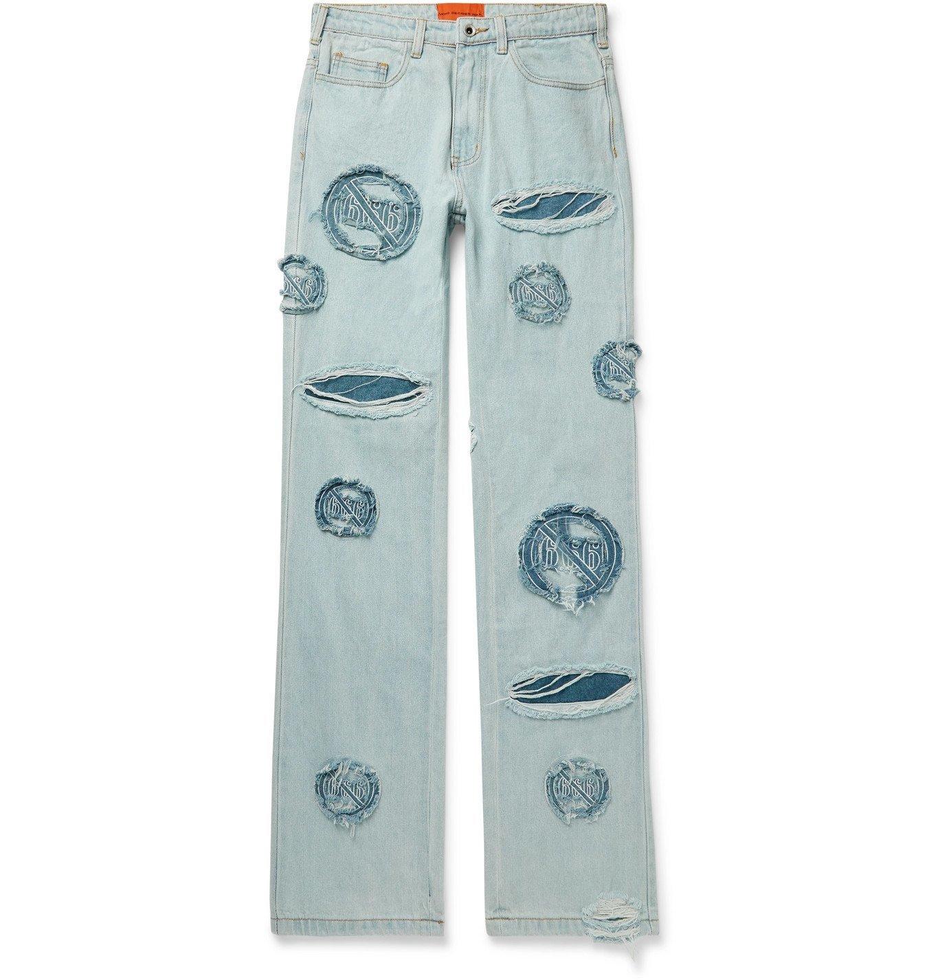 Photo: WHO DECIDES WAR by Ev Bravado - Distressed Appliquéd Denim Jeans - Blue
