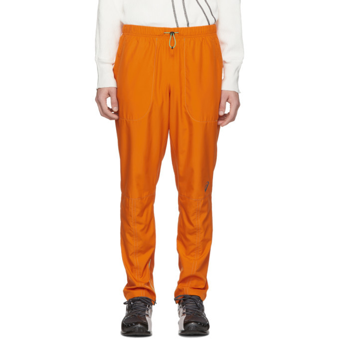 Photo: Kiko Kostadinov Orange Asics Edition Woven Track Pants