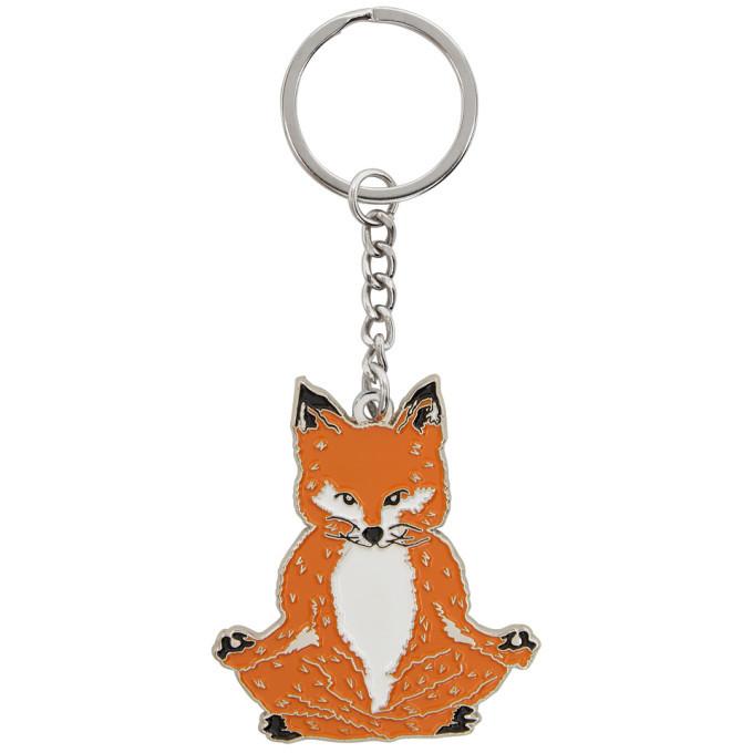 Photo: Maison Kitsune Orange Lotus Fox Keychain