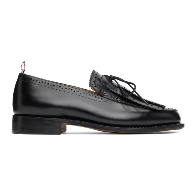 Photo: Thom Browne Black Perforated Kilted Loafers