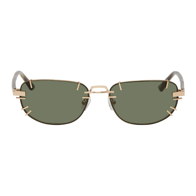 Photo: Y/Project Gold and Green Linda Farrow Edition Trinity Sunglasses