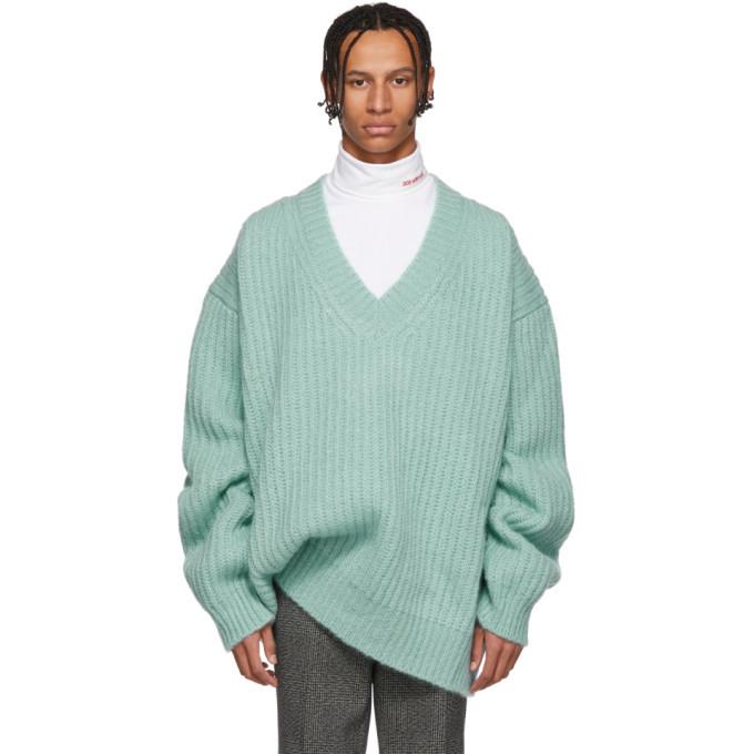 Photo: Calvin Klein 205W39NYC Blue Oversize V-Neck Sweater